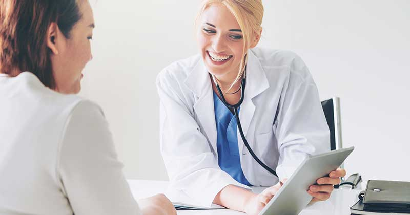 doctor using medical billing services with patient