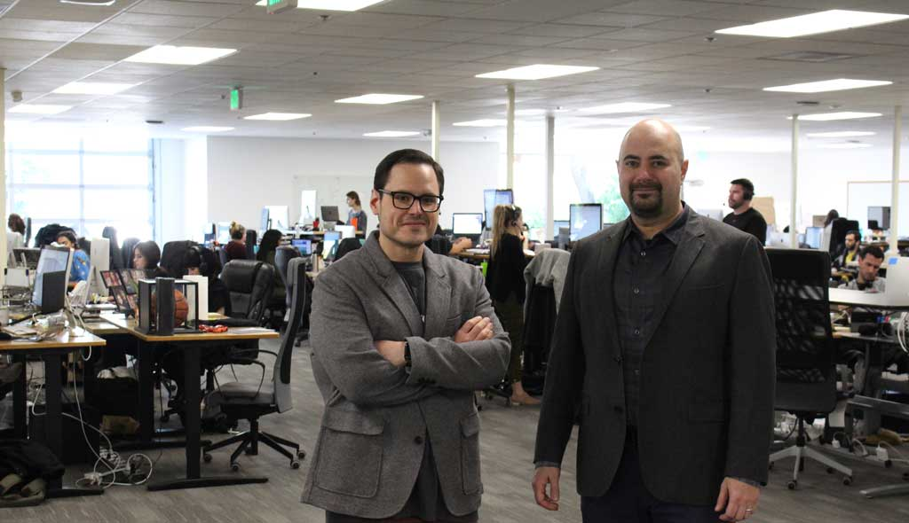 Michael and Daniel, CEO and COO, of DrChrono standing in their sunnyvale building